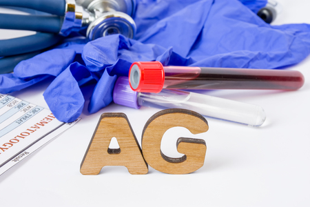 AG Medical laboratory acronym or abbreviation of antigen, immune response component, piece and immune system. Letters AG are near laboratory test tubes with blood sample, stethoscope, protection glove