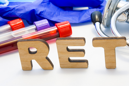 RET abbreviature mean Reticulocyte Count with lab tubes with blood and stethoscope. Using acronym RET in laboratory clinical diagnosis, determination of pathologies contacts to increase or deficiency