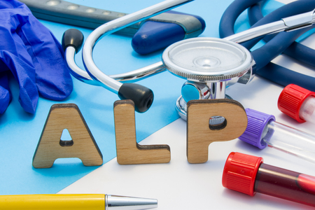 ALP Medical lab acronym, meaning Alkaline Phosphatase. Letters that make word of ALP, located near test tubes with blood, stethoscope and other diagnostic tools and devices, latex gloves