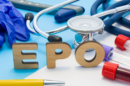 EPO Medical lab acronym, meaning erythropoietin in blood. Letters that make word of EPO, located near test tubes with blood, stethoscope and other diagnostic tools and devices, latex gloves Stok Fotoğraf