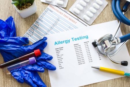 Result of allergy testing on working table in working environment of doctor of internal medicine, allergologist, general practice, pediatrician top view top-down photo surrounded by stethoscope, drugs Stok Fotoğraf