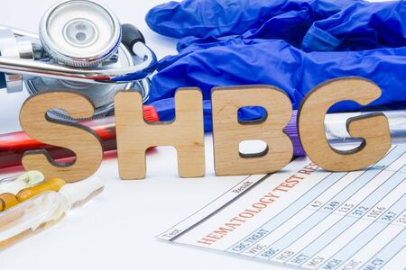 SHBG laboratory medical abbreviation sex hormone-binding globulin concept photo. On table is laboratory acronym SHBG next to tubes of blood, other biological fluids, result analysis, stethoscope
