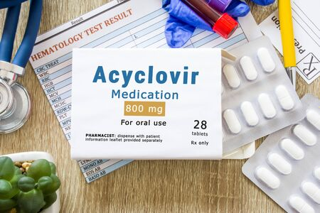 Acyclovir medication as international nonproprietary or generic name concept photo. Packaging of drugs labeled