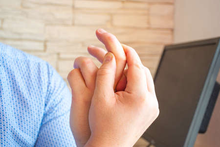 Patient holds onto index finger and indicates localization of pain, inability to move, numbness and other symptoms due to trauma, damage to nerves or joints. Concept photo of arthritis, neuritis