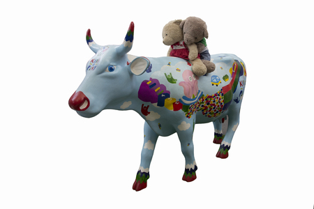 dolby: big cow and bare doll on white background Used in the decoration department  By Bear on the bull statue