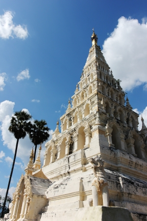 grandiose: White Pagoda with blue sky  Thailand is hot and sunny  Centuries-old pagodas under the rain and sun but still strong and grandiose