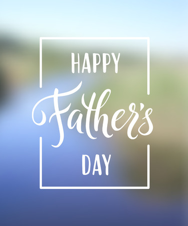 Happy Fathers Day greeting. Hand drawn lettering for greeting card on a blurred background
