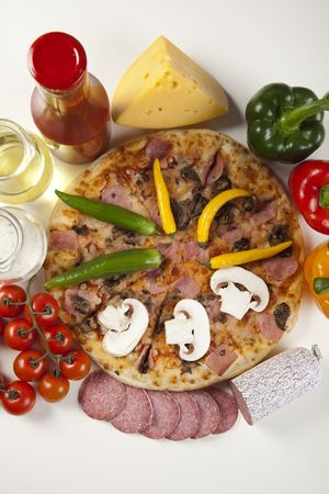 A couple of delicious pizzas, with raw tomatoes, green peppers and mushrooms photo