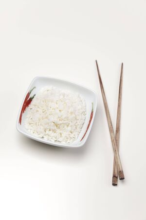 perfectly: A bowl of perfectly cooked, plain Basmati rice, in an Asian style bowl, with a garnish of Thai Basil