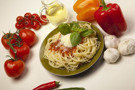 Spaghetti, tomato, cheese and basil photo