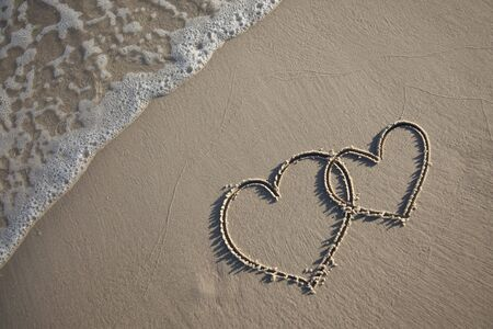 Heart on sand Stock Photo