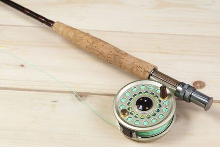 Fly fishing rod and reel with a yellow popping bug