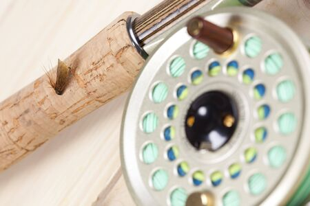 Fly fishing rod and reel with a yellow popping bug Stock Photo - 5787833