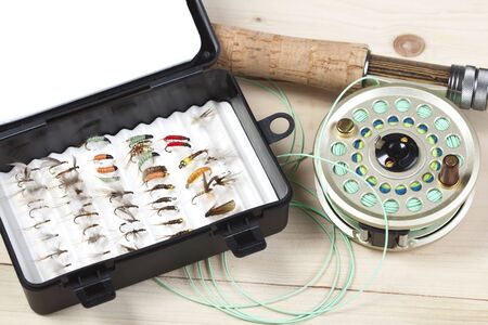 outdoor pursuit: Fly fishing rod and reel with a yellow popping bug