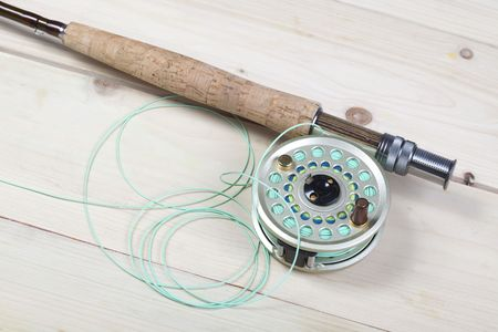 Fly fishing rod and reel with a yellow popping bug Stock Photo - 5787848