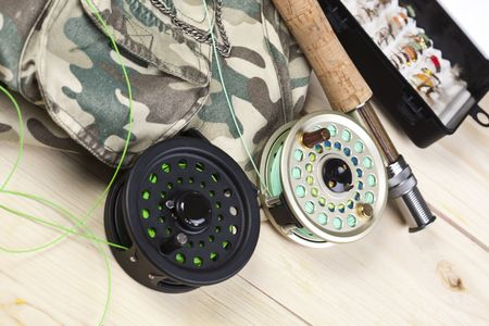 Fly fishing rod and reel with a yellow popping bug Stock Photo - 5787839