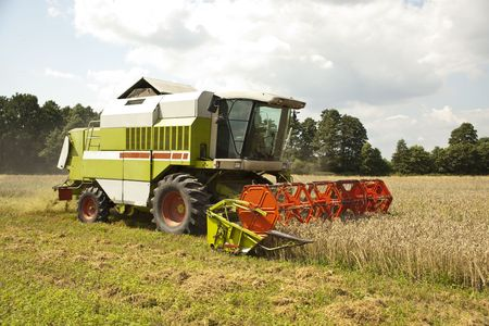 A big green combine Stock Photo - 6508730