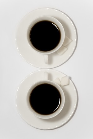 breakfast smiley face: Cups of fresh coffee on white background