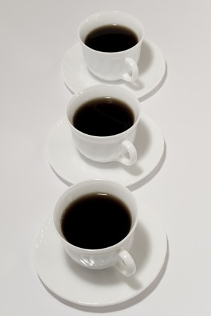 Cups of fresh coffee on white background photo