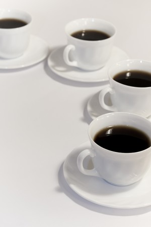 coffee hour: Cups of fresh coffee on white background
