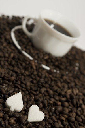 coffee hour: A rich cup of hot coffee, with fresh roasted beans