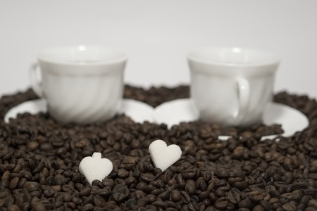 coffee hour: A rich cups of hot coffee, with fresh roasted beans