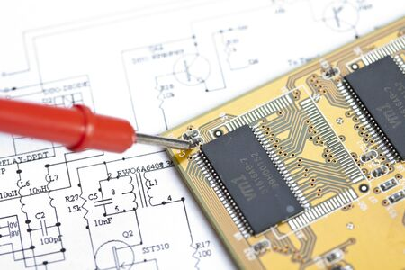 Electronic components on a schematic diagram background. Stock Photo - 8005659