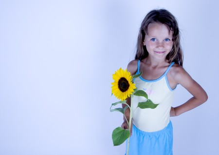 A little girl with a beautiful flower photo