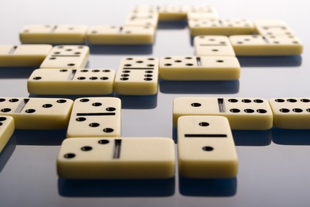 Domino on blue background photo