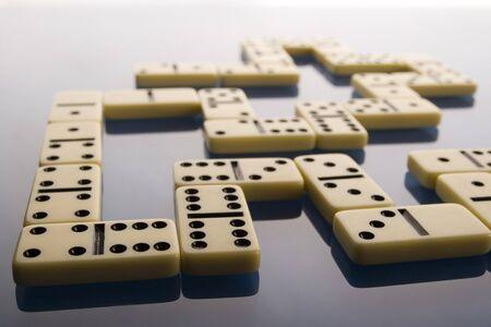 Domino on blue background photo