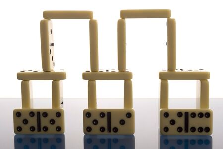 topple: Domino on blue background