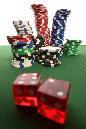 Poker chips and red dice photo