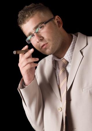 Businessman smoking cigar Stock Photo - 8044922
