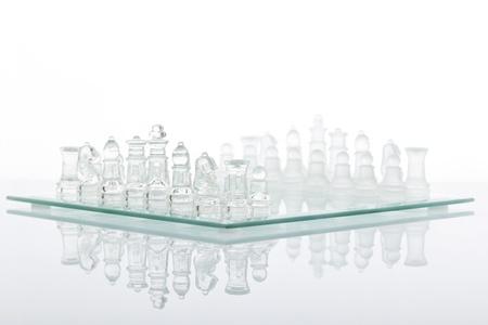 Beautiful glass chess on a white background. Stock Photo - 8795311
