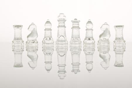 Beautiful glass chess on a glass countertop. Stock Photo - 8795518