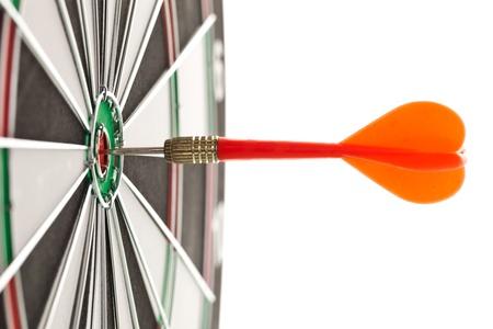 Darts hitting the bullseye on a dartboard photo