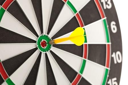 Shallow depth of field shot of darts in bullseye on dartboard photo