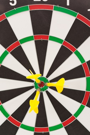 Yellow dart hitting the target for the shield photo
