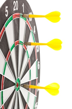 darts flying: Yellow darts hitting the target for the shield Stock Photo