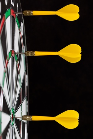 darts flying: Yellow darts on black background