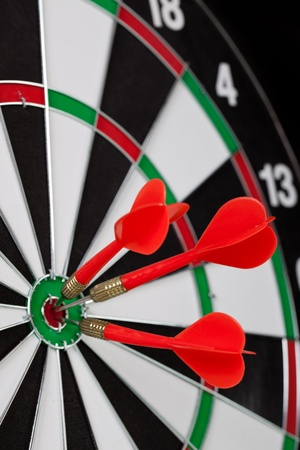 darts flying: Red darts on black background Stock Photo
