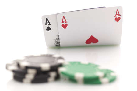 Poker cards and gambling chips on white background photo