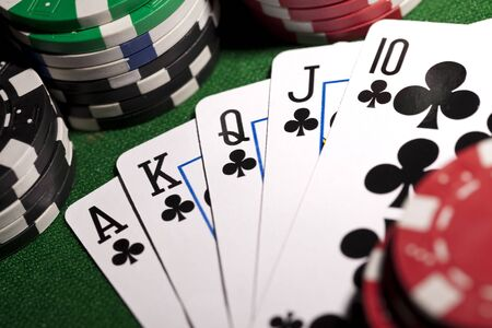 Poker cards and gambling chips Stock Photo