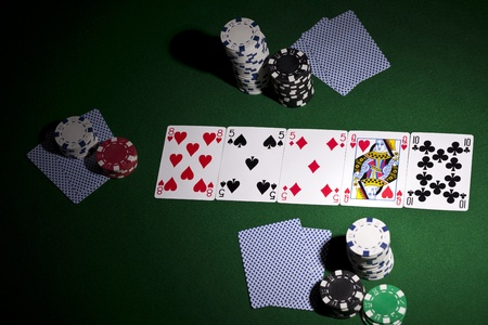Poker cards and gambling chips on green background Stock Photo - 11706270