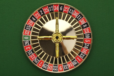 roulette wheel: Beautiful gold roulette on a green background.