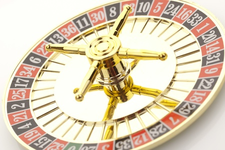 Beautiful gold roulette on a white background. Stock Photo - 12310198
