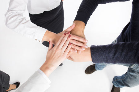 joined hands: concept of teamwork. business people joined hands