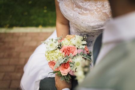 bridesmaids: Close up of bride and bridesmaids bouquet