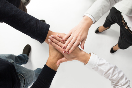 hands joined: concept of teamwork. business people joined hands