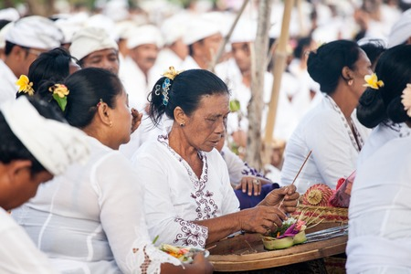 prior: BALI, Indonesia - MAR 9, 2013: Local people during performed Melasti Ritual. Melasti is a Hindu Balinese purification ceremony and ritual is held several days prior to the Nyepi holy day. Editorial